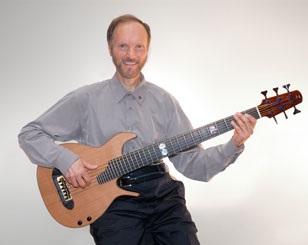 Rich K with his 6-string Brazilian bass guitar by Gary  Zimnicki.